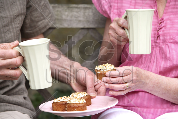 senior man and woman enjoying their teatime stock photo