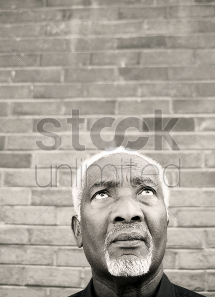 senior man looking up stock photo