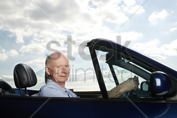 senior man traveling in the car stock photo