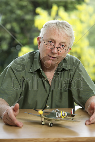 senior man with a model airplane stock photo