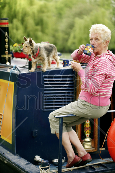 senior woman enjoying a cup of coffee stock photo