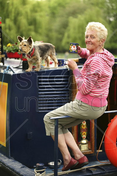 senior woman holding a cup of coffee stock photo
