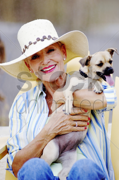 senior woman posing with her dog stock photo