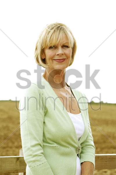 senior woman smiling at the camera stock photo