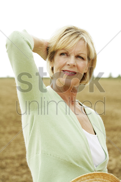 senior woman thinking stock photo