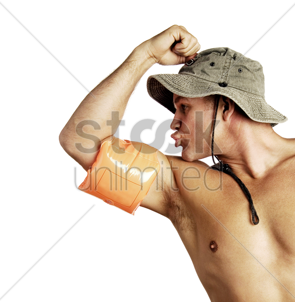 shirtless man showing off his muscles stock photo