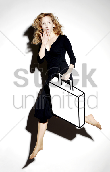 shocked businesswoman carrying a briefcase stock photo