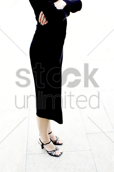 shoulder down shot of a woman in all black stock photo