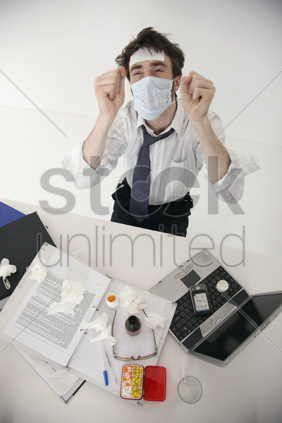 sick man wearing surgical mask cheering stock photo