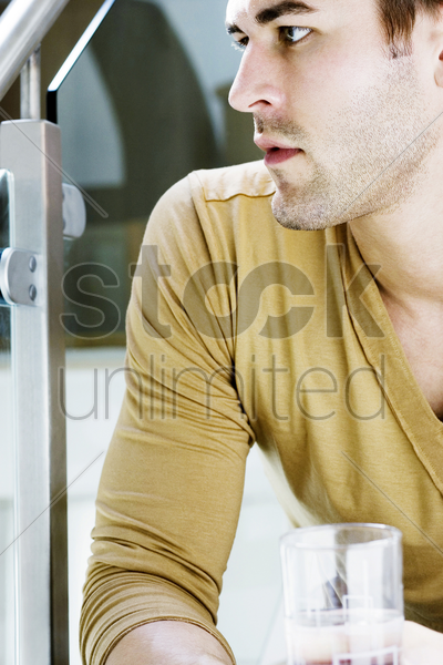 side view of a man holding a glass stock photo