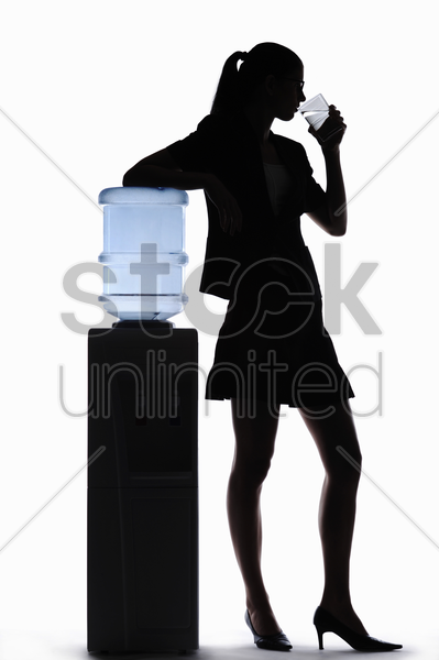 silhouette of businesswoman drinking water stock photo