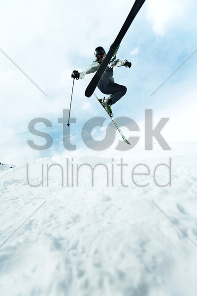 skier flying in the air stock photo