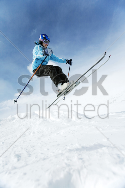 skier performing a jump stock photo