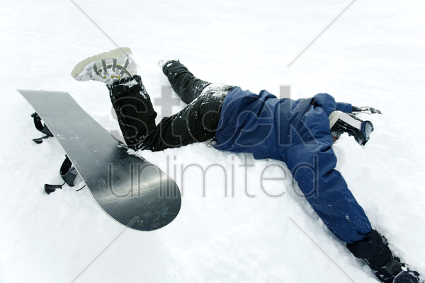 snowboarder with his face on the snow stock photo
