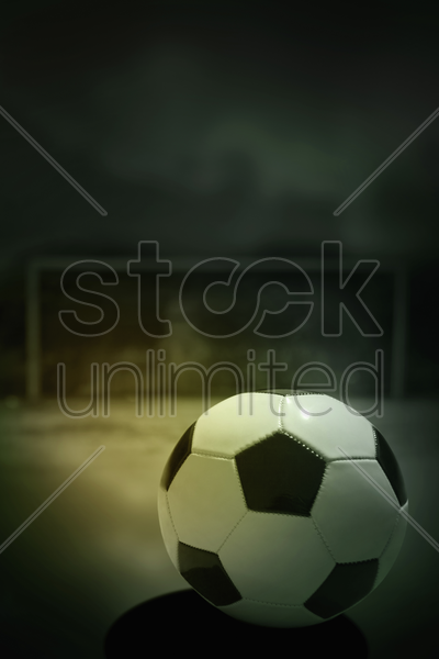 soccer ball on playing field stock photo