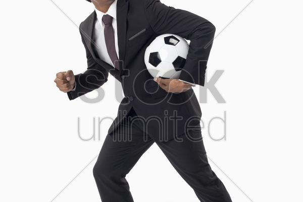 soccer manager holding a ball stock photo