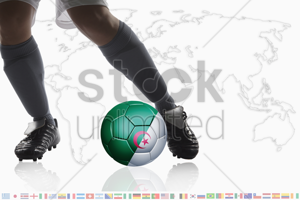 soccer player dribble a soccer ball with algeria flag stock photo