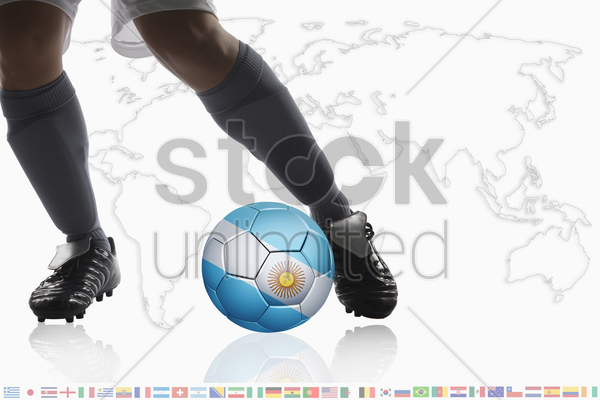 soccer player dribble a soccer ball with argentina flag stock photo