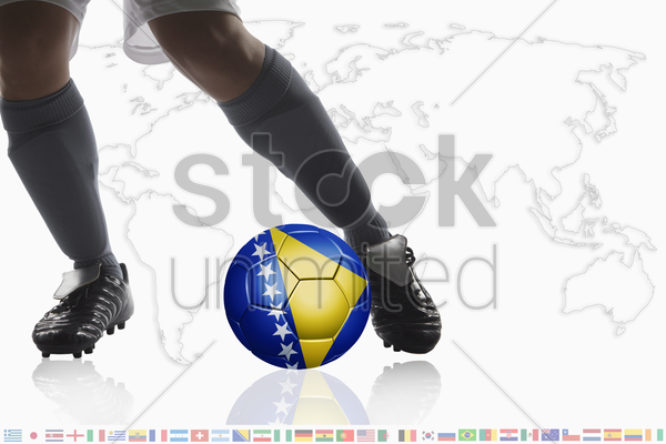 soccer player dribble a soccer ball with bosnia and herzegovina flag stock photo