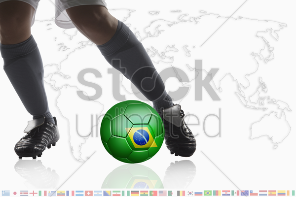 soccer player dribble a soccer ball with brazil flag stock photo