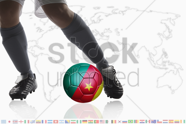 soccer player dribble a soccer ball with cameroon flag stock photo