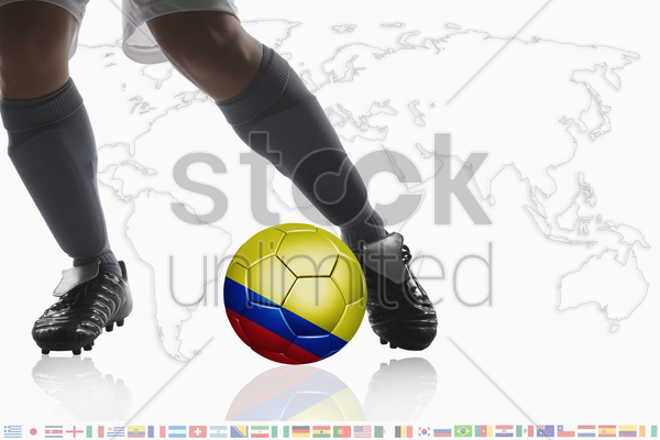 soccer player dribble a soccer ball with colombia flag stock photo
