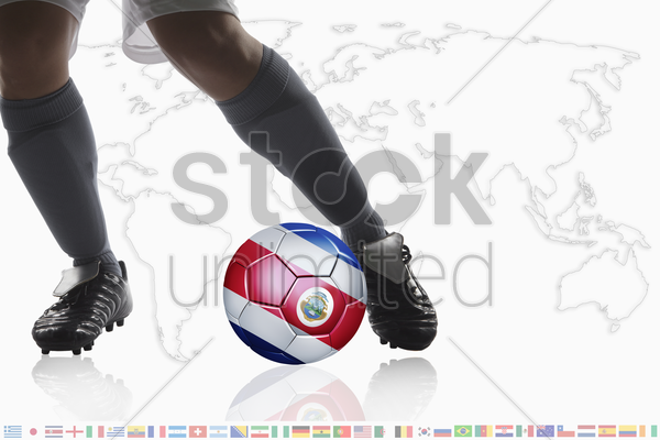 soccer player dribble a soccer ball with costa rica flag stock photo
