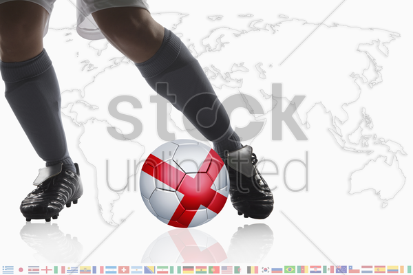 soccer player dribble a soccer ball with england flag stock photo
