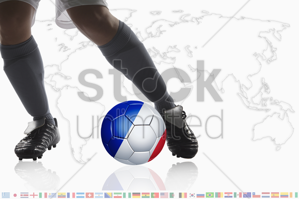 soccer player dribble a soccer ball with france flag stock photo