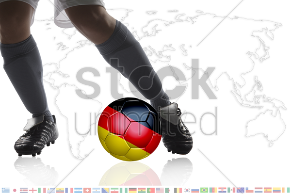 soccer player dribble a soccer ball with germany flag stock photo