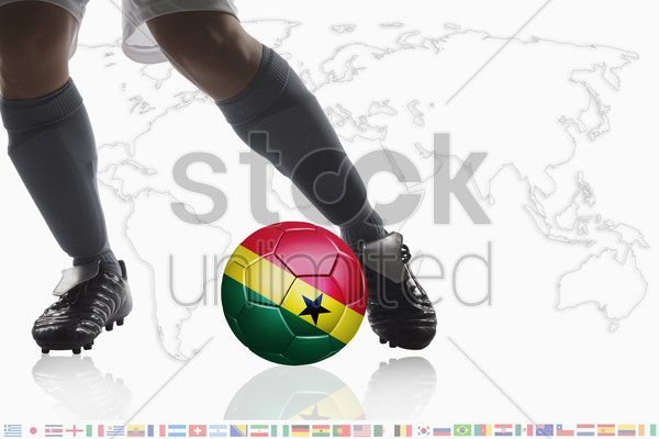 soccer player dribble a soccer ball with ghana flag stock photo