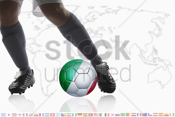 soccer player dribble a soccer ball with italy flag stock photo