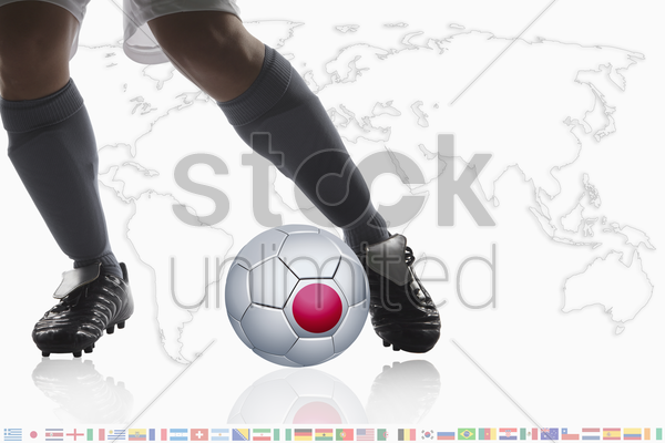 soccer player dribble a soccer ball with japan flag stock photo
