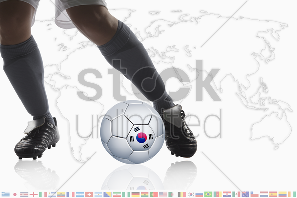 soccer player dribble a soccer ball with korea republic flag stock photo