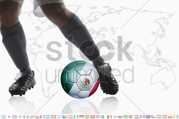 soccer player dribble a soccer ball with mexico flag stock photo