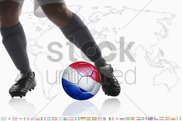 soccer player dribble a soccer ball with netherlands flag stock photo
