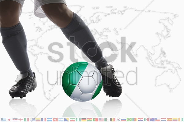 soccer player dribble a soccer ball with nigeria flag stock photo