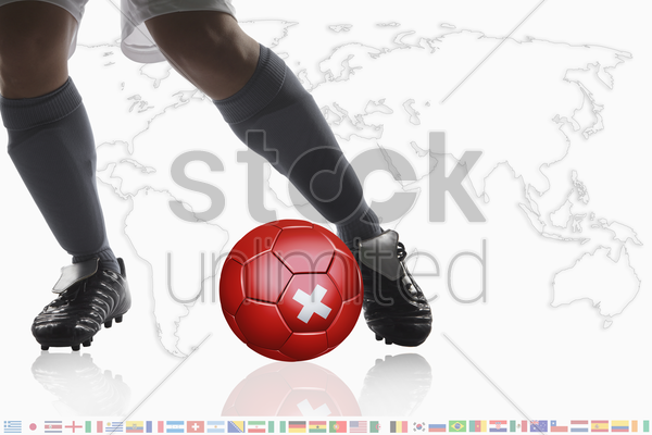 soccer player dribble a soccer ball with switzerland flag stock photo