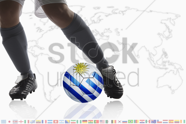 soccer player dribble a soccer ball with uruguay flag stock photo
