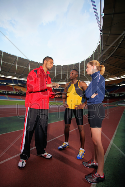sports coach giving instruction stock photo