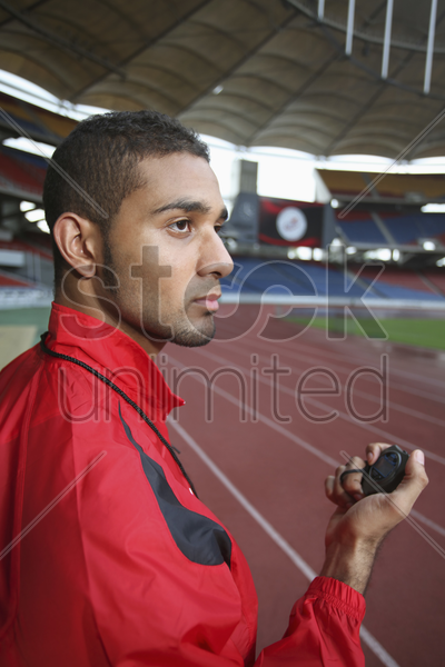 sports coach with stopwatch stock photo