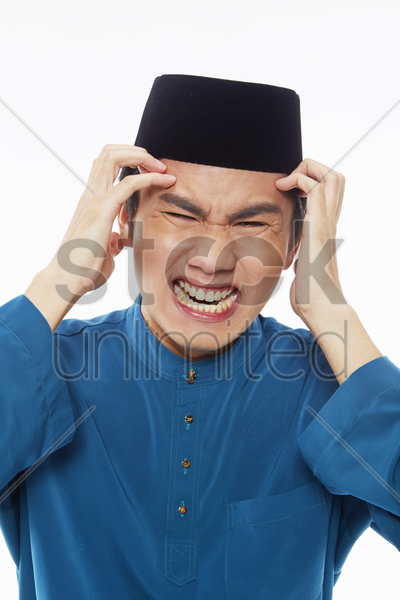 stressed man touching his forehead stock photo