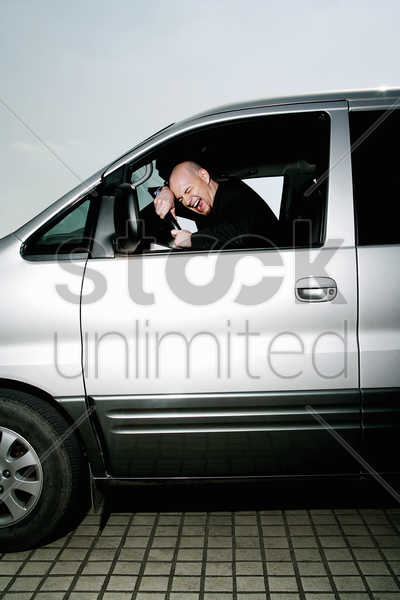 stressed out businessman screaming in the car stock photo