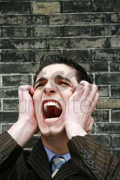 stressed out businessman screaming stock photo