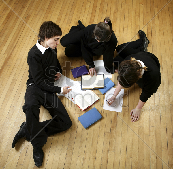 students having discussion stock photo