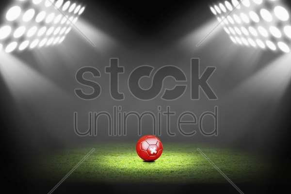 switzerland ball on the soccer field stock photo
