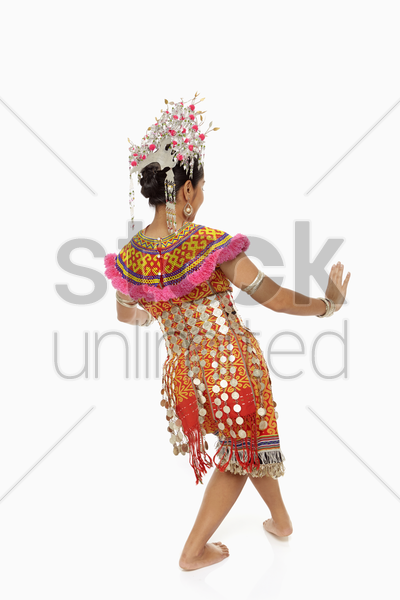 talented woman in an iban traditional clothing dancing stock photo