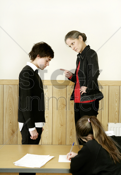 teacher scolding her student stock photo