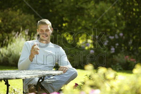 teenage boy listening to music on a portable mp3 player stock photo