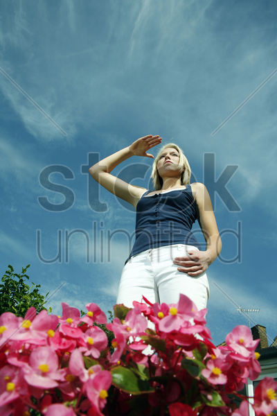 teenage girl shielding her face stock photo